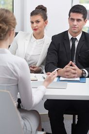 pic of office romance  - Young business employees hiding  office romance - JPG