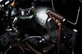 foto of levers  - Close up of leather covered motorcycle step starter lever on vintage bike - JPG