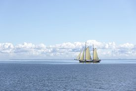 image of sloop  - Sailing ship in the open blue sea - JPG