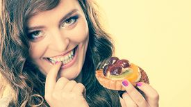 stock photo of finger-licking  - Sweetness and happiness concept - JPG