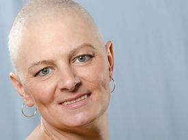 pic of chemotherapy  - Portrait of happy cancer survivor in studio after successful chemotherapy - JPG