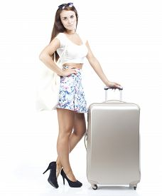 foto of disappointed  - Unhappy and disappointed tourist woman with suitcase isolated white - JPG
