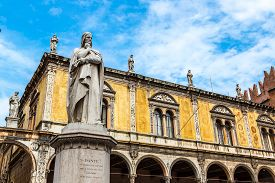 picture of alighieri  - Statue of Dante Alighieri in a summer day in Verona Italy - JPG