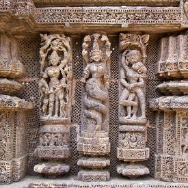 stock photo of kamasutra  - Famous erotic stone carving on the wall of ancient Sun temple in Konark - JPG