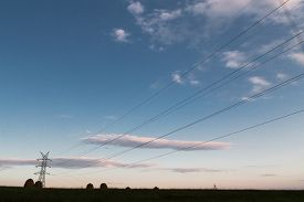 pic of electricity pylon  - A long line of electrical transmission towers  - JPG