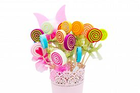 stock photo of lolli  - Vase of fake flowers with different colors - JPG