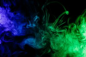 foto of hookah  - Abstract art. Colour blue-green smoke hookah on a black background. Background for Halloween. Texture fog. Design element. The concept of poison gas.