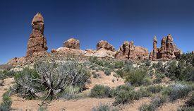 stock photo of hoodoo  - Panoramic of Stone pinnacle formations sometimes called hoodoos in Arches National Park near Moab Utah - JPG