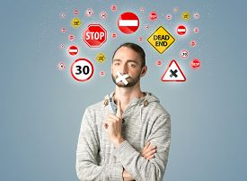 pic of traffic signal  - Young man with taped mouth and traffic signals around his head   - JPG
