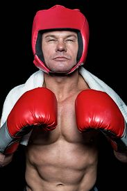 image of headgear  - Portrait of confident boxer in red headgear and gloves - JPG