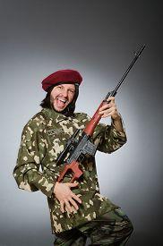 image of handgun  - Soldier with handgun against gray - JPG