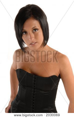 Attractive Female In Corset Looking Up