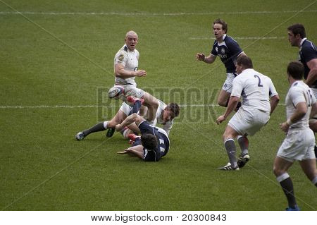 TWICKENHAM LONDON - MAR 13: Scottish player fumbles ball at England vs Scotland, England playing in white Win 22 -16, at RBS Six Nations Rugby Match on March 13, 2011 in Twickenham, England.