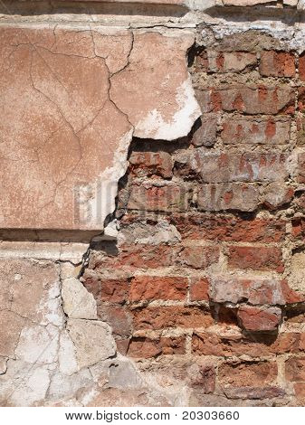 Color photograph of old brick walls and crumbling plaster