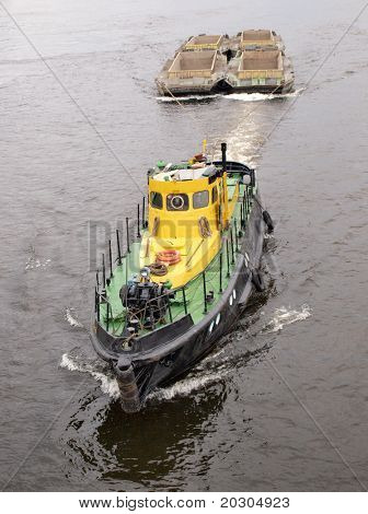 Color photograph of a large river tug on water