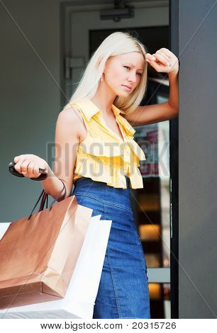 Young woman in a shop doorway