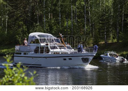 VARKAUS, FINLAND ON JULY 03. View of the surrounding by a lake where boat, people and tourists meet on July 03, 2017 in Varkaus, Finland. Unidentified people, boats. Editorial use.