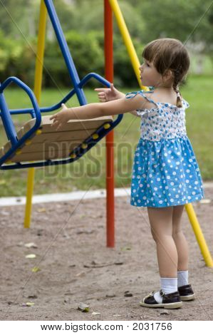 Girl Playing With Swing