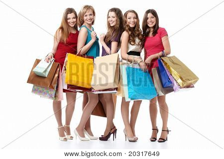Five attractive young women with shopping on white background