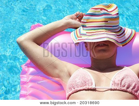 woman relaxing on lilo
