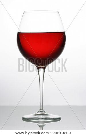 backlit red wine glass