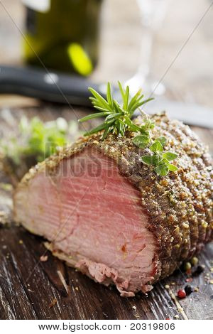 nice piece of roasted sirloin beef covered in herbs