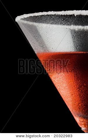 Closeup of moisture on a cosmopolitan glass with a black background