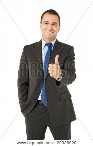 Portrait of smiling businessman looking at camera and showing thumbs up sign