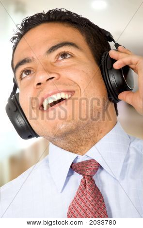 Business Man Listening To Music