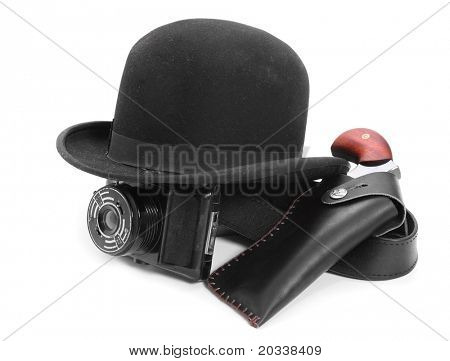 Black bowler hat, camera and pistol. Vintage spying equipment on white background.