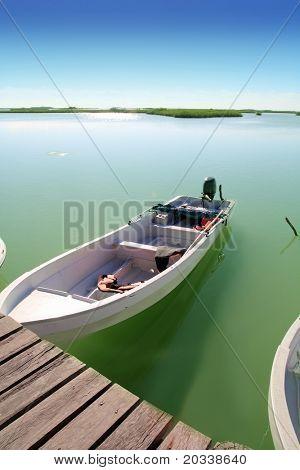 boats in pier mangrove lagoon in Mayan Riviera sian kaan
