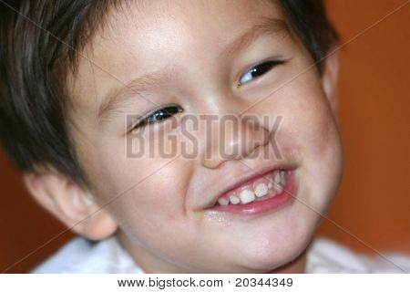 Smiling mixed Asian Caucasian 2 years old toddler