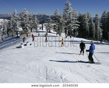 Skiers in busy ski resort