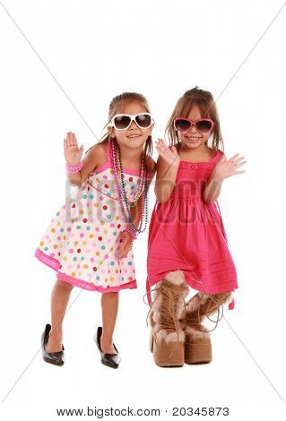 Two adorable sisters on pure white background