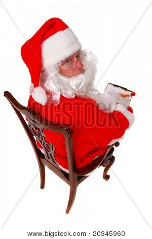Santa Claus taking notes on white background