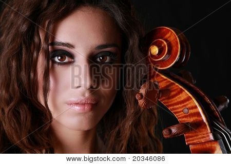Beautiful Woman with Cello with dramatic lighting