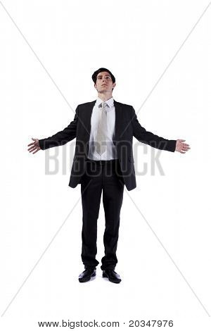 Businessman meditating with his eyes closed and arms open (isolated on white)