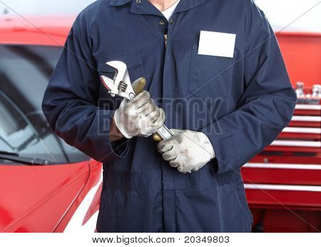Mechanic with wrench.  Auto repair shop service.