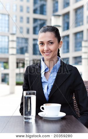 Businesswoman Having Break
