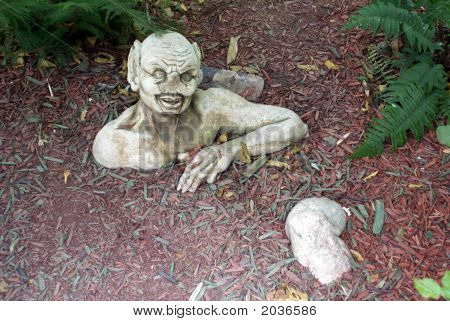 Statue/Sculpture Of Devil/Satan Coming Out Of Ground