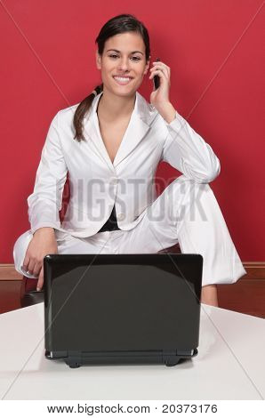 Smart business woman holding cell phone and smiling