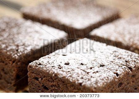 Chocolate Brownies Being Sprinkled Powdered Sugar