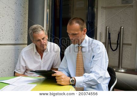 two businessmen discussing at the meeting