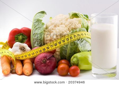 healthy food with measure tape indicating weight loss