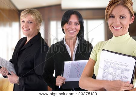 business team of three women at the office