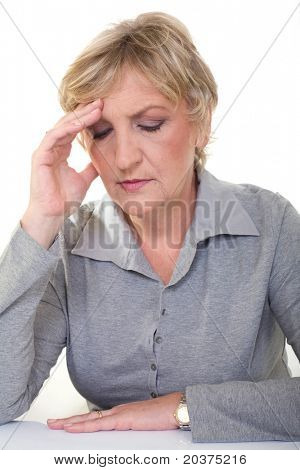 senior woman is having headache