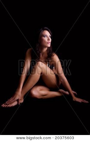 beautiful woman posing in studio, muscular sport body