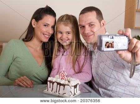 father is taking family photo for daughter`s 6 birthday