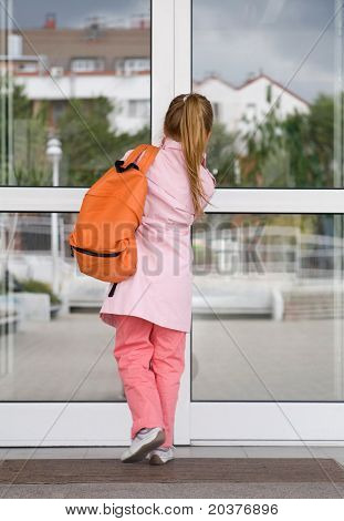 girl entering the school building