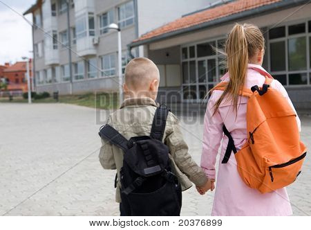 two elementary students are going to school